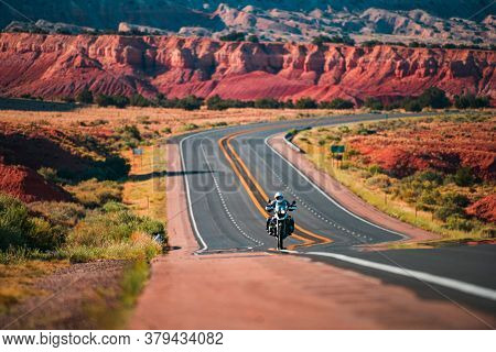 Biker Driving On The Highway On Legendary Route 66, Arizona. Panoramic Picture Of A Scenic Road, Usa