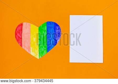 Heart In Lgbtq Colors And White Mockup Blank On Bright Orange Background, Top View, Copy Space