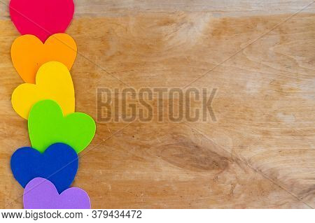 Hearts In Lgbtq Colors On Wooden Background, Top View, Copy Space