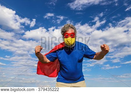 Super hero defender of the universe wearing a facemask during worldwide pandemic