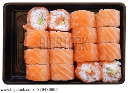 Sushi salmon raw fish with rice meal on plastic tray