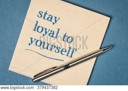 stay loyal to yourself inspirational note - handwriting on a napkin, integrity and personal development concept