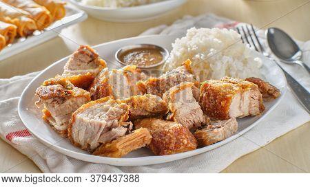 crispy filipino lechon kawali with white rice