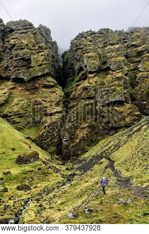 Iceland hiking tourist hiker sightseeing visiting Raudfeldsgja Canyon gorge rift nature landscape on the Snaefellsnes peninsula, West Iceland.