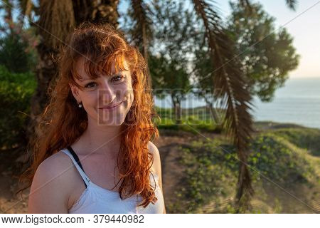Lima, Lima / Peru - January 2 2016: White Woman With Red Hair And A Lot Wrinkles Smiles In The Sunse