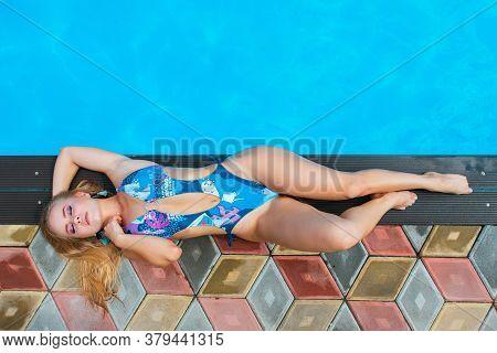 Fashion Portrait Of Beautiful Sexy Young Women Laying Near Swimming Pool