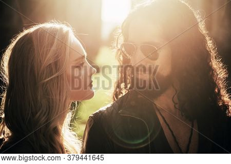 Couple In Love. Beautiful Blonde Woman Looking At Her Handsome Boyfriend. Pair Of Sweethearts Walkin
