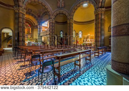 ALBA, ITALY - JUNE 23, 2020: Interior view of the nave, wooden pews and altar in Madonna della Moretta church in Alba - small town in Piedmont, famous for truffles and wine production.