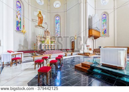 ALBA, ITALY - JUNE 23, 2020: Interiors of Divin Maestro - a roman catholic parish church recently renovated, located in small town of Alba in Piedmont, Northern Italy.