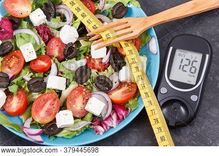 Glucose Meter With Sugar Level, Centimeter And Fresh Prepared Greek Salad. Diabetes, Slimming, Healt
