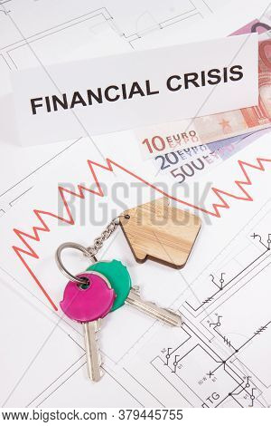 Home Keys, Inscription Crisis, Currencies Euro And Downward Graphs Representing Financial Crisis Of