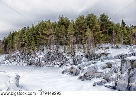 Karelian Rocks And Pine Forest In Winter