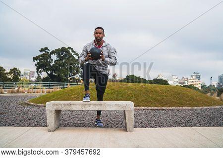 Athletic Man Training With Medicine Ball.