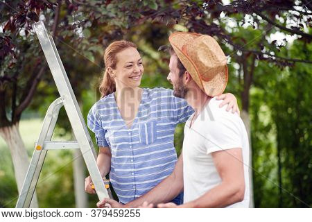 Happy spouses in the garden on a beautiful day