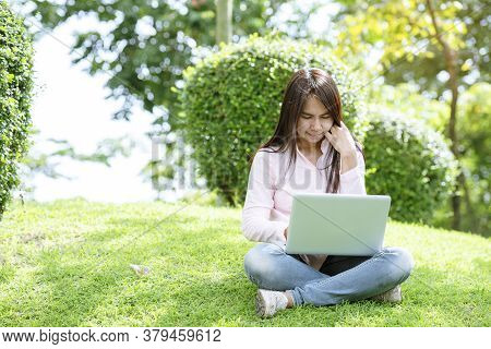 Asian Woman Sitting Green Park Using Laptop Computer. Woman Working On Laptop Happy Entrepreneur Bus
