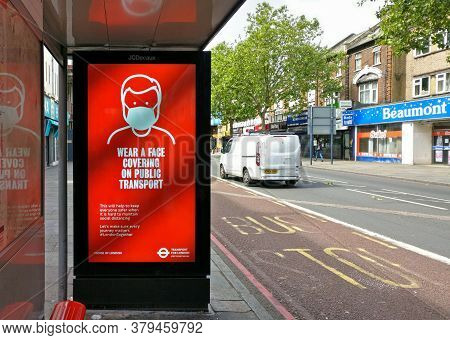 London, United Kingdom - June 06, 2020: Light Ad At Lewisham Bus Stop Prompting Passengers To Wear P