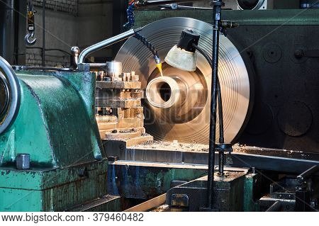 Machining An Oil Cooled Part On A Lathe Close-up, Rotating Parts Are Blurred In Motion