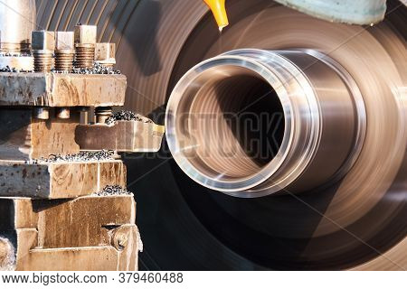 Turning An Oil Cooled Part On A Lathe Close-up, Rotating Parts Are Blurred In Motion