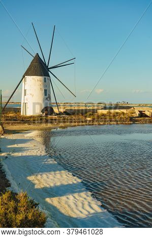 Old Historic Windmill In Salt Marshes At San Pedro Del Pinatar Park, Murcia Spain. Tourist Attractio