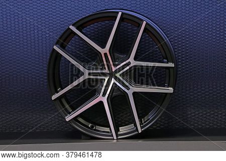 Alloy Wheel Of Car On The Shelf With Blue Background. Alloy Wheels Are Wheels That Are Made From An