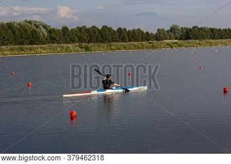 Sports Male Athlete Trains On A Kayak. Kayaking On The River. Water Active Sports. Single Person Row