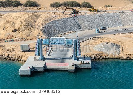 Ismailia, Egypt - November 14, 2019: Port Said - Suez Canal Rd And A Concrete Pier On The Banks Of T