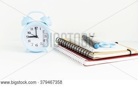 Time To School And Education Concept. Books With Pencil Holder On White Table. Blackboard In Backgro