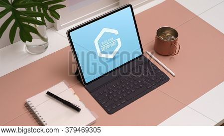 Workspace With Mock Up Digital Tablet, Accessories, Stationery And Decorations On Home Office Desk