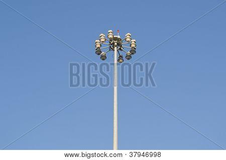 MODERN STREET LIGHT OVER A BLUE SKY