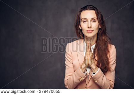 Adult Caucasian Woman With Please Gesture On Grey Dark Background With Copy Space