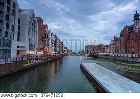 Gdansk, Poland - August 2, 2020:Amazing architecture of Gdansk old town at dusk from a new footbridge over the Motlawa River. Poland