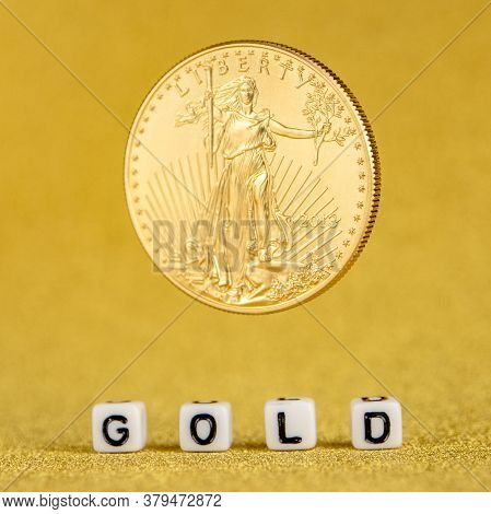 Golden American Eagle One Ounce Coin Levitating On The Letters Gold Made Of White Dices With Golden