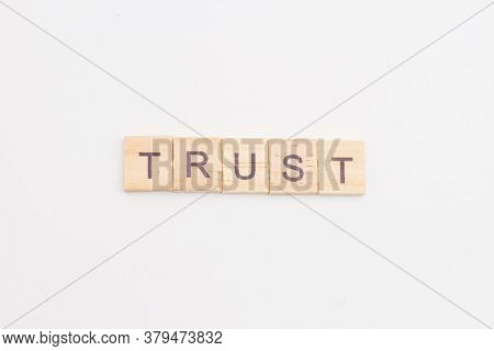 Wooden Blocks With Letters And Words Trust. Trust Relationships