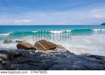 Surin Beach, Phuket Thailand. Small Wave And Rocks With Blue Sky.sea View.