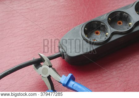 Nippers With Blue Handles Cut The Cable Splitter Cable. Emergency Disconnection Of The Consumer From
