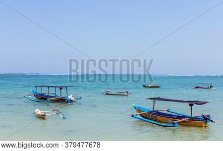 Bali, Indonesia - September 17, 2019: Bali Beach with boats and sand