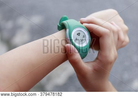 Close Up Girl Using Smartwatch Touching Button And Touchscreen On Active Sports. Finger Touch Button