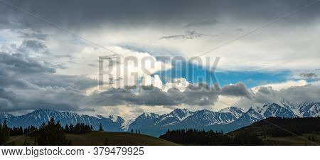 View Of The Snow-capped Mountains With Clouds Before A Thunderstorm