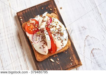 Toast With Egg, Tomatoes, Vegetables And Spices.