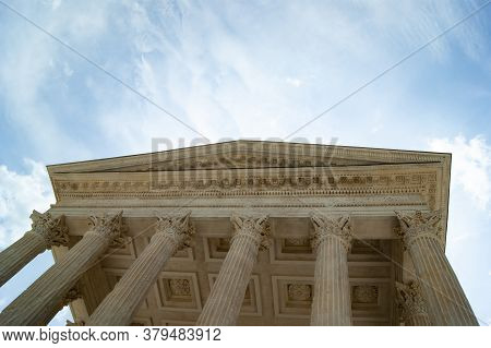 The Maison Carree In The Beautiful Southern French City Of Nimes.  A Perfectly Preserved Roman Templ