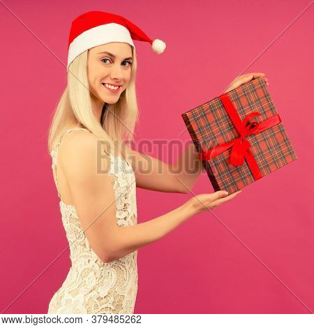 A Beautiful Athletic Transgender Man In A New Year's Hat And White Dress, Hold In Hands Gifts. Celeb