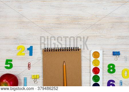 School Supplies, Office Supplies On A Light Wood Background. Flat Lay, Top View. Place For An Inscri