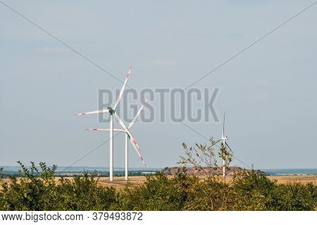 Wind Turbines In An Arid Landscape. An Alternative Way Of Generating Electricity From The Wind. Inno