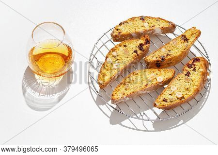 Sweet Cantuccini Biscuits And Sweet Wine. Homemade Italian Biscotti Cookies On White Table.