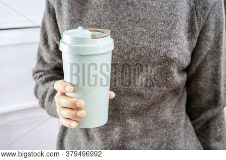 Girl Holds In Her Hands Reusable Eco Coffee Cup. Zero Waste Concept. Ban Single Use Plastic. Take Aw