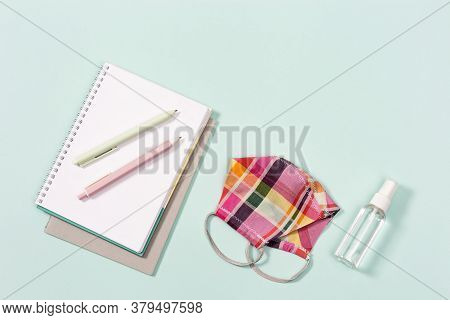 School Supplies, Cloth Face Mask For Girl And Hand Sanitizer, Copybooks, Pens On Neo Mint Paper Back
