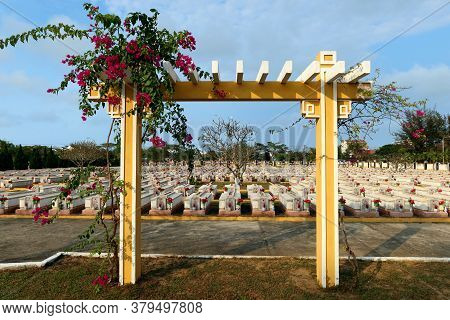Hoi An, Vietnam, February 29, 2020: Arch With Flowers Next To The Graves Of Soldiers Killed During T