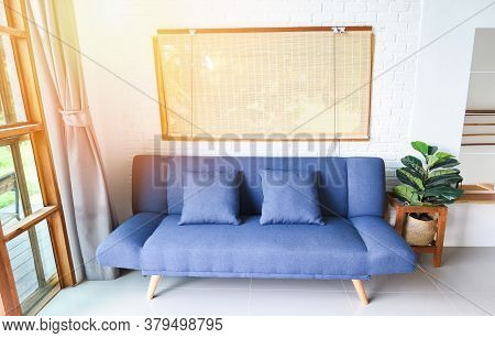 Modern Sofa Interior In The Minimal Room / Living Room In Minimal Style With Wooden Board For Artwor