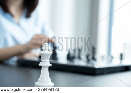 King Standing In Front Of People Hand Move Chess With Strategy And Tactic To Win Enemy, Play Battle