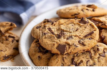 Closeup Of A Pile Of Chocolate Chip Cookies On A Plate